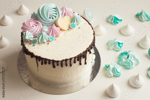 Birthday Cake With Colorful Meringues On White Background Concept Of Candy Table Bar