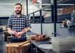 Bearded butcher holds fresh meat.