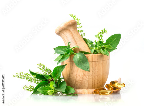Fototapeta Sweet basil and hot basil in wooden mortar with essential oil and supplement, alternative herbal medicine concept obraz