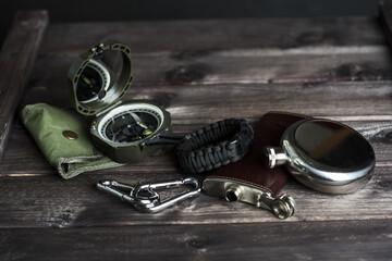 Travellers set for outdoor activity. Compass, watch, flask, carabiner
