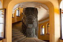 The Old Elevator In The Entran...