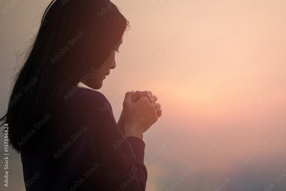 Fototapety, obrazy: Christian woman praying worship at sunset. Hands folded in prayer. worship god with christian concept religion.