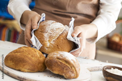Foto op Plexiglas Brood Female hand holding hot freshly baked bread