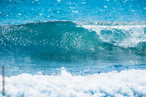 Keuken foto achterwand Water Wave in tropical ocean. Blue barrel crashing, clear water and sun light