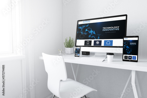 Fotografiet  devices on white minimal workspace innovative website