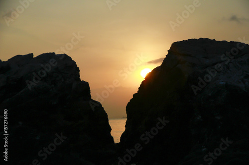 Poster Marron chocolat Stock Photo - Beautiful sunset between the mountains and the sea