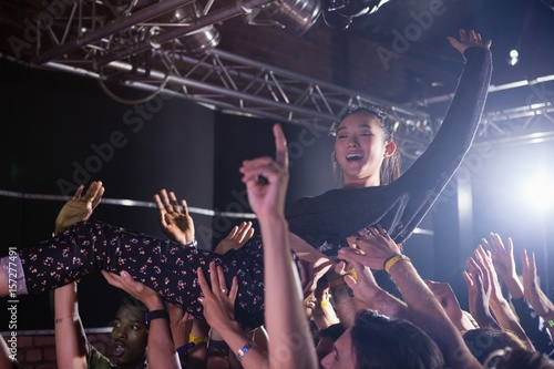 Photo Crowd surfing at a concert