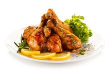 Roast Chicken Drumsticks On White Background