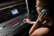 Female Audio Engineer Using So...
