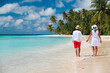 happy loving couple walking on beach