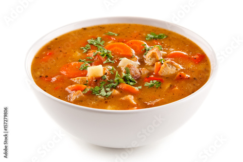 Tomato soup with carrot and chicken on white background