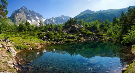 Fototapeta na wymiar Mountain Lake in the highlands of the Caucasus