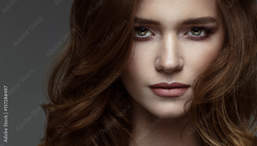 Fototapeta Portrait of young woman with dramatic look