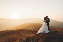 Wedding Couple Posing On Sunse...