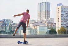 Single Leg Hoverboard Ride. Man In The City.