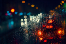 Blurry Cars And Lights In Traffic In A Rainy Night Seen Through Windscreen