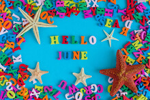 Hello June - Word Composed Of Small Colored Letters At Blue Background With Beach Attribute - Starfish Or Five-finger. Summerbeginning And Vacation Concept