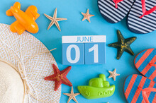 June 1st. Image Of June 1 Calendar On Blue Background With Summer Beach, Traveler Outfit And Accessories. First Summer Day. Happy Childrens Day