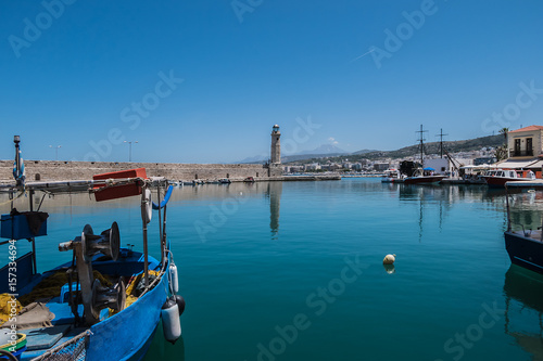 City on the water The old Venetian harbor with Lighthouse in Rethymno. Crete, Greece.