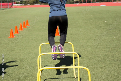 Valokuva  Jumping over hurdles during practice