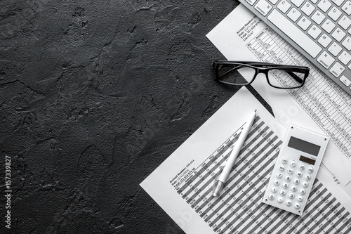 Fotomural taxes accounting in office work space on dark desk background top view mockup