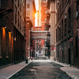 Fototapeta Nowy York - New York City street at sunset time. Old scenic street in TriBeCa district in Manhattan.