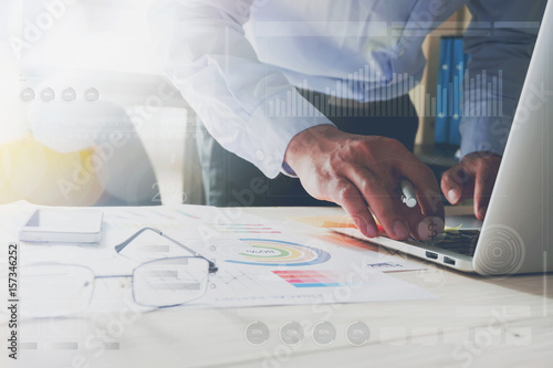 Fototapeta businessman hand working with laptop on wooden desk in office. can be used on an ad obraz