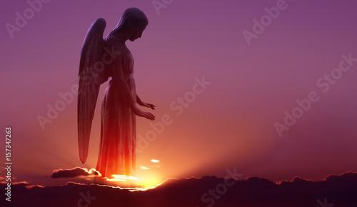Fotografiet  Angel in heaven over purple sky background