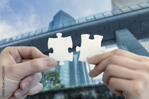 man and woman hand holding jigsaw puzzles, business matching concept Canvas Print