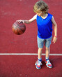 Young basketball player with a ball