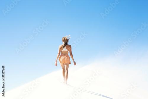Girl walking through minimal landscape