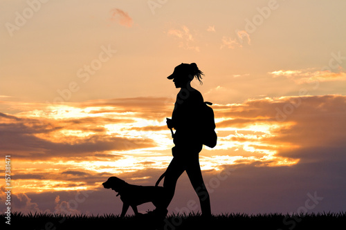 Foto op Aluminium Jacht girl with dog at sunset
