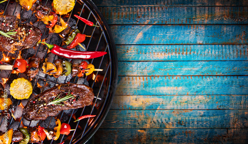 Recess Fitting Grill / Barbecue Barbecue grill with beef steaks, close-up.