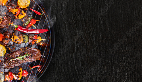 Aluminium Prints Grill / Barbecue Barbecue grill with beef steaks, close-up.