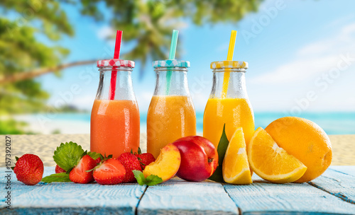 Recess Fitting Juice Fresh smoothie drinks placed on wooden planks, blur beach on background