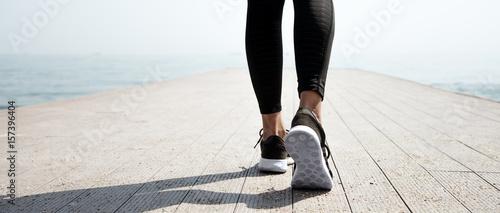 Fényképezés  Young beautiful sportive girl preparing to run