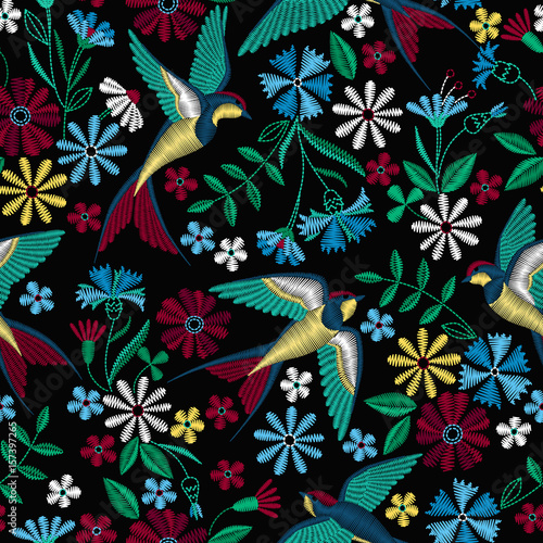 Cotton fabric Embroidery seamless pattern with swallow birds and beautiful flowers. Vector embroidery for fashion textile and fabric.