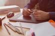 Workplace of designer. Illustrator draws a sketch