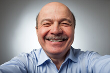 Elderly Man Laughs From Ear To Ear, Giggles On The Funny Stories. Be Happy Of News Or Events