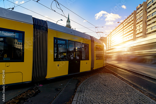 Foto  Modern electric tram yellow color on the streets of Berlin