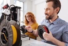 Joyful Positive Man Connecting Filament To The 3d Printer