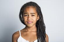 Adorable Sad African Little Girl On Studio Gray Background