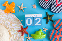 June 2nd. Image Of June 2 Calendar On Blue Background With Summer Beach, Traveler Outfit And Accessories. Summertime Concept