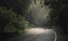 Asian Men And Woman Cyclist Are Cycling Road Bike Morning Uphill On The Road