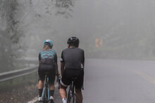Asian Men And Woman Cyclist Ar...