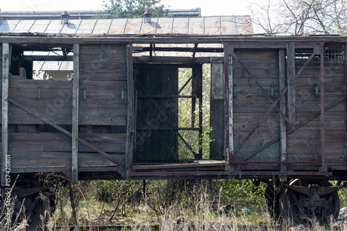 Fotografie, Obraz  Old wooden ruined boxcar