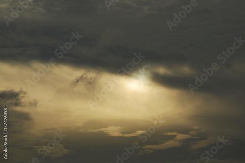 sun behind dark cloud look a like eye on sky Fototapet