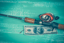 Fishing Rod And Money Lure