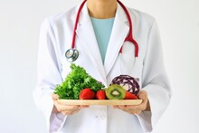 Doctor Holding Fresh Fruit And...