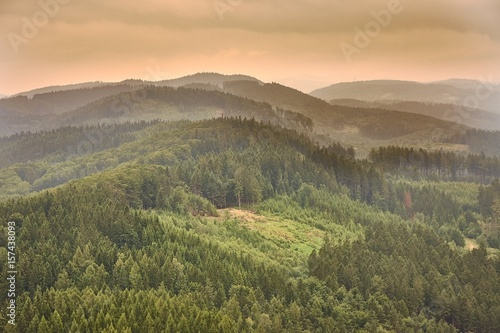 Tuinposter Heuvel Hilly landscape at dusk